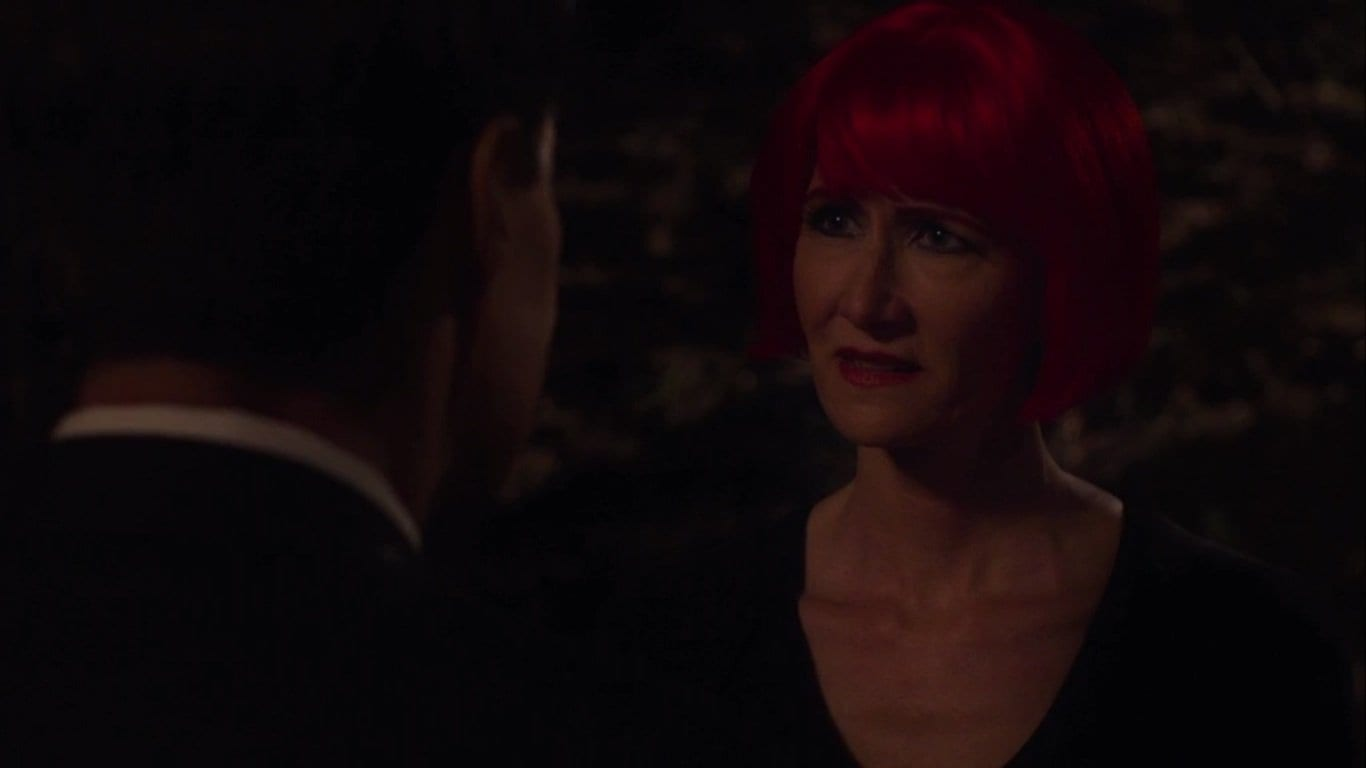 Diane with bright red hair meets Cooper in the woods