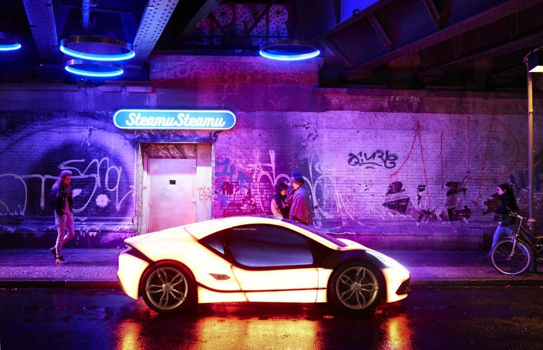 a neon car on a street in Mute