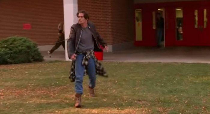 Bobby Briggs, dancing backwards towards the school door