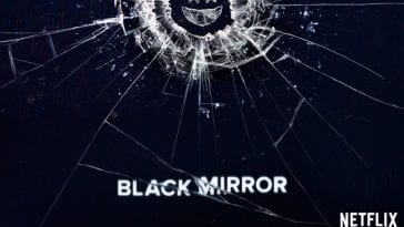 A cracked phone screen shows a smile in a promo for Black Mirror