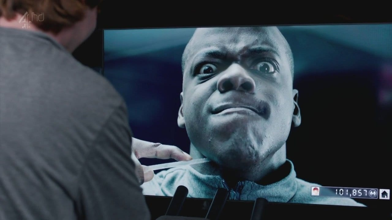 """Bing puts a shard of glass against his throat in Black Mirror """"Fifteen Million Merits"""""""