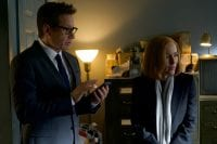 Mulder and Scully in an office
