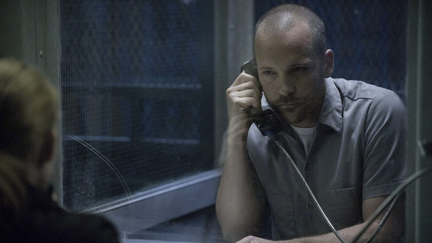 Peter Sarsgaard as Ray Seward in The Killing talking on a phone from within a prison