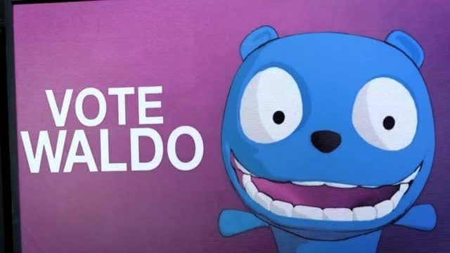 "Waldo appears on a poster that says ""Vote Waldo"""