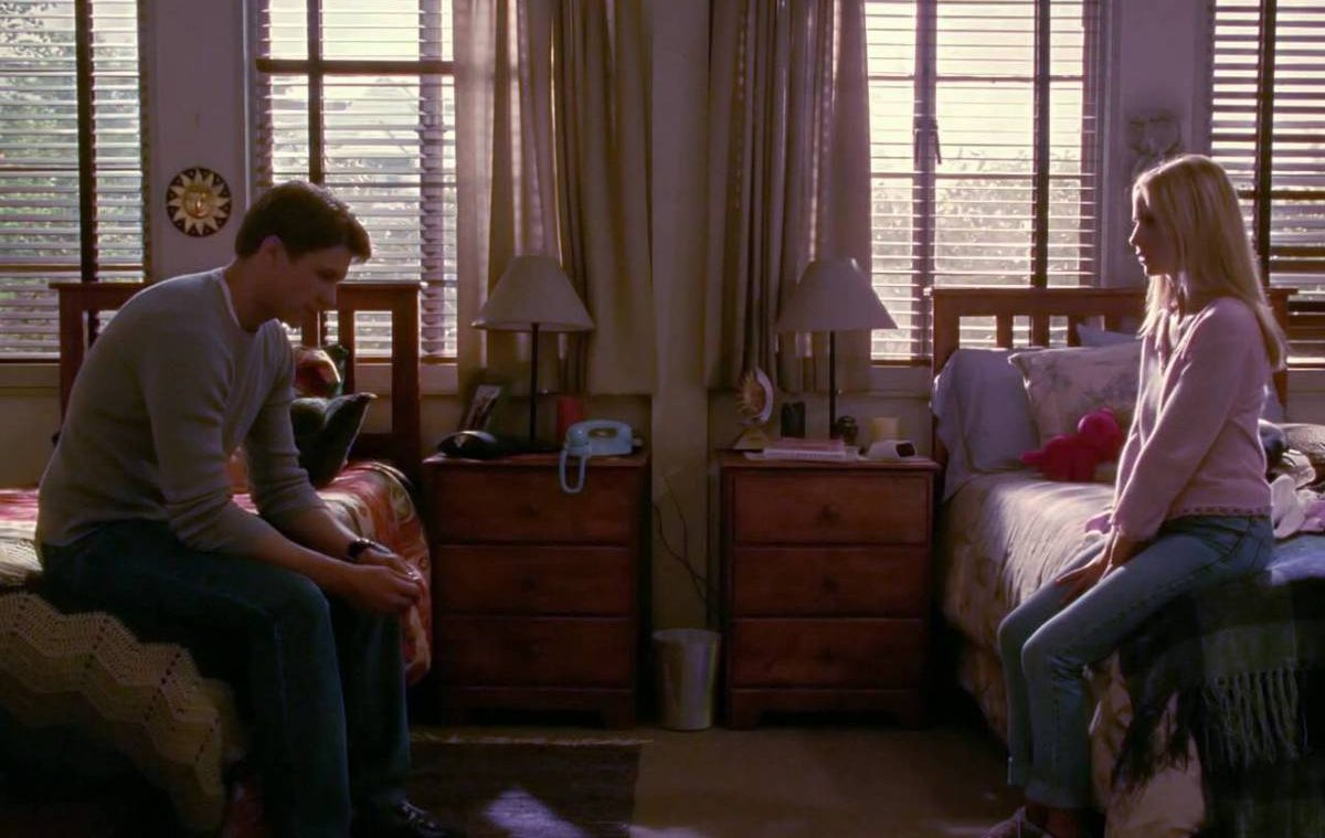 Riley and Buffy sit on opposite beds not finding the words to say to each other