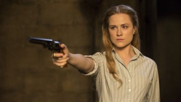 Dolores points a gun