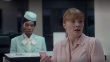 Lacie turns in shock from an airport counter in Black Mirror Nosedive