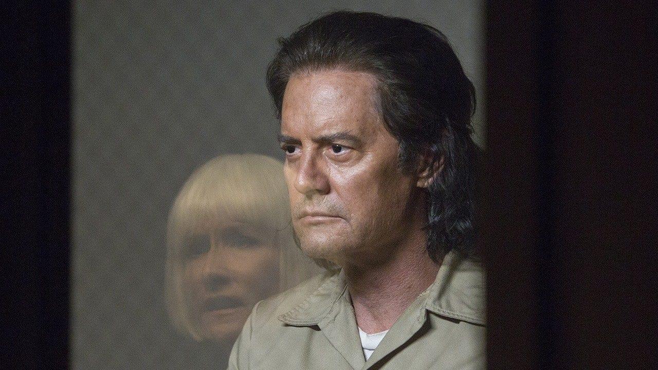 Mr C looks at Diane through prison glass