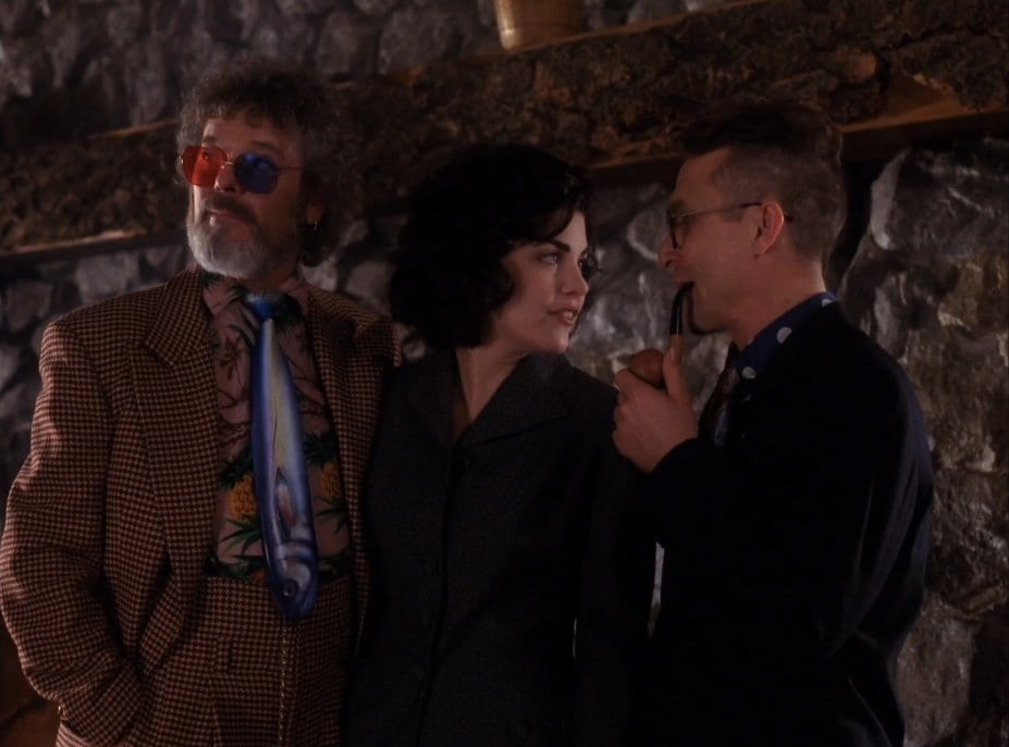 Dr Jacoby wears a fish tie, Audrey and Jerry talk