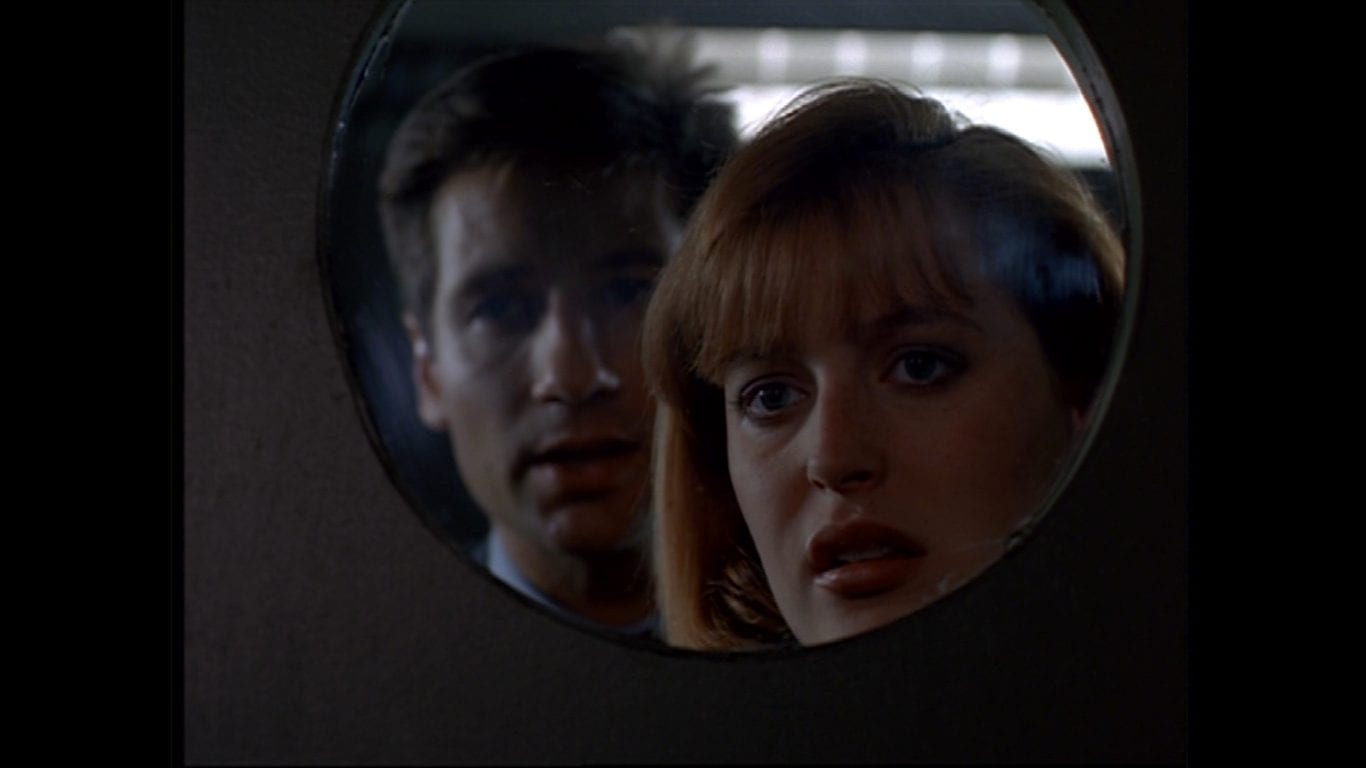 David Duchovny as Fox Mulder with Dana Scully in The XFiles