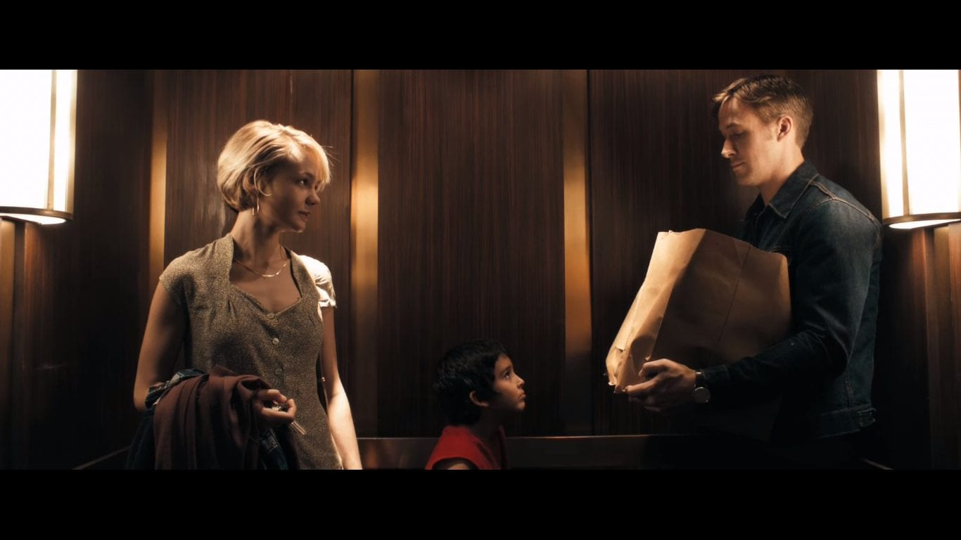 Carey Mulligan and Ryan Gosling in Drive, standing in an elevator with a little boy