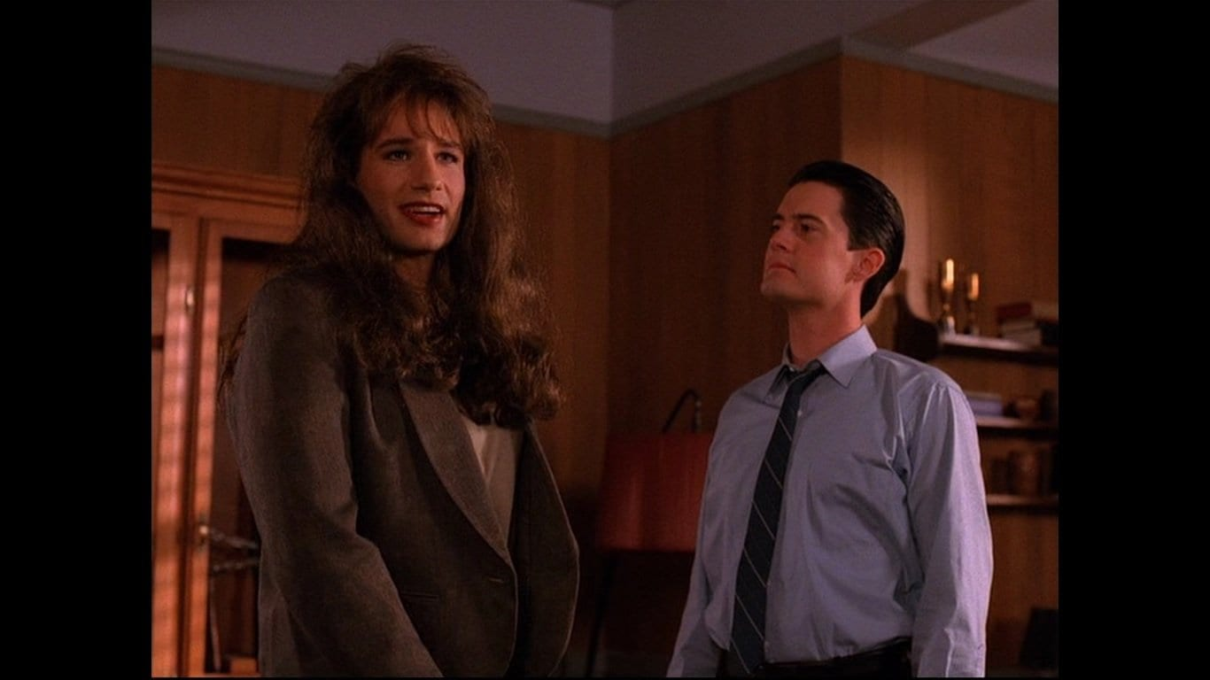 Denise stands next to Agent Cooper smiling