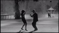 a man and woman dance in the dark in fellinis 8 1/2
