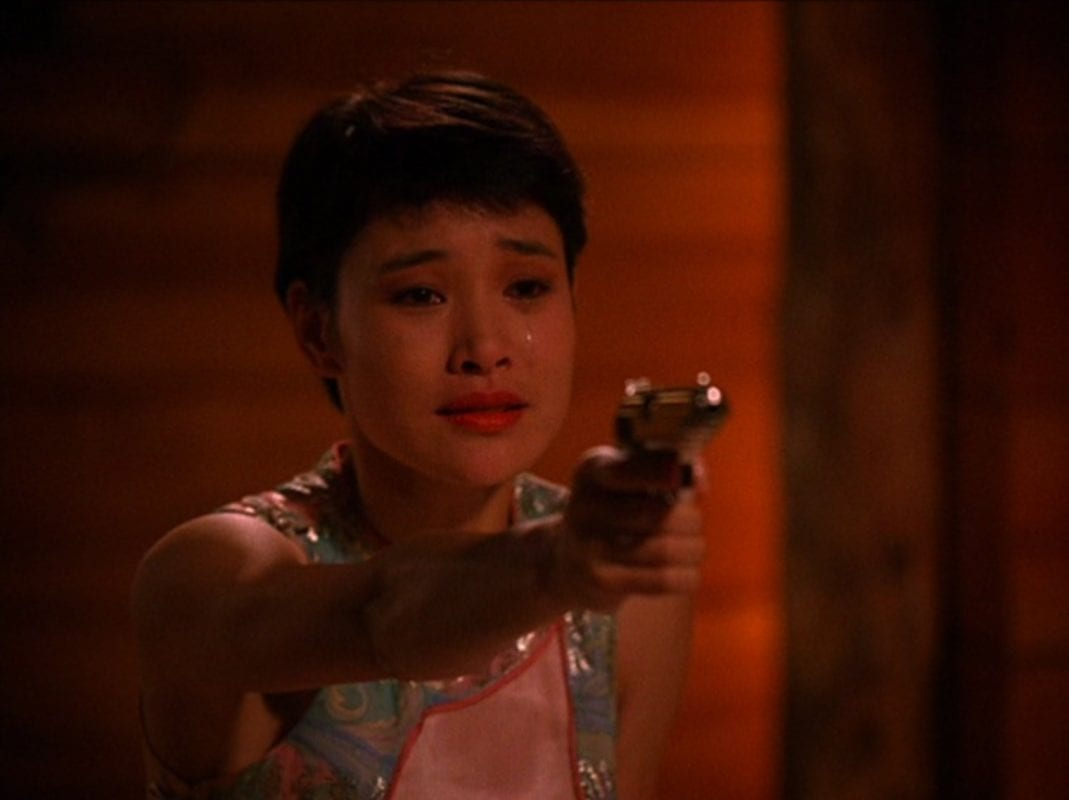Josie holds a gun while crying