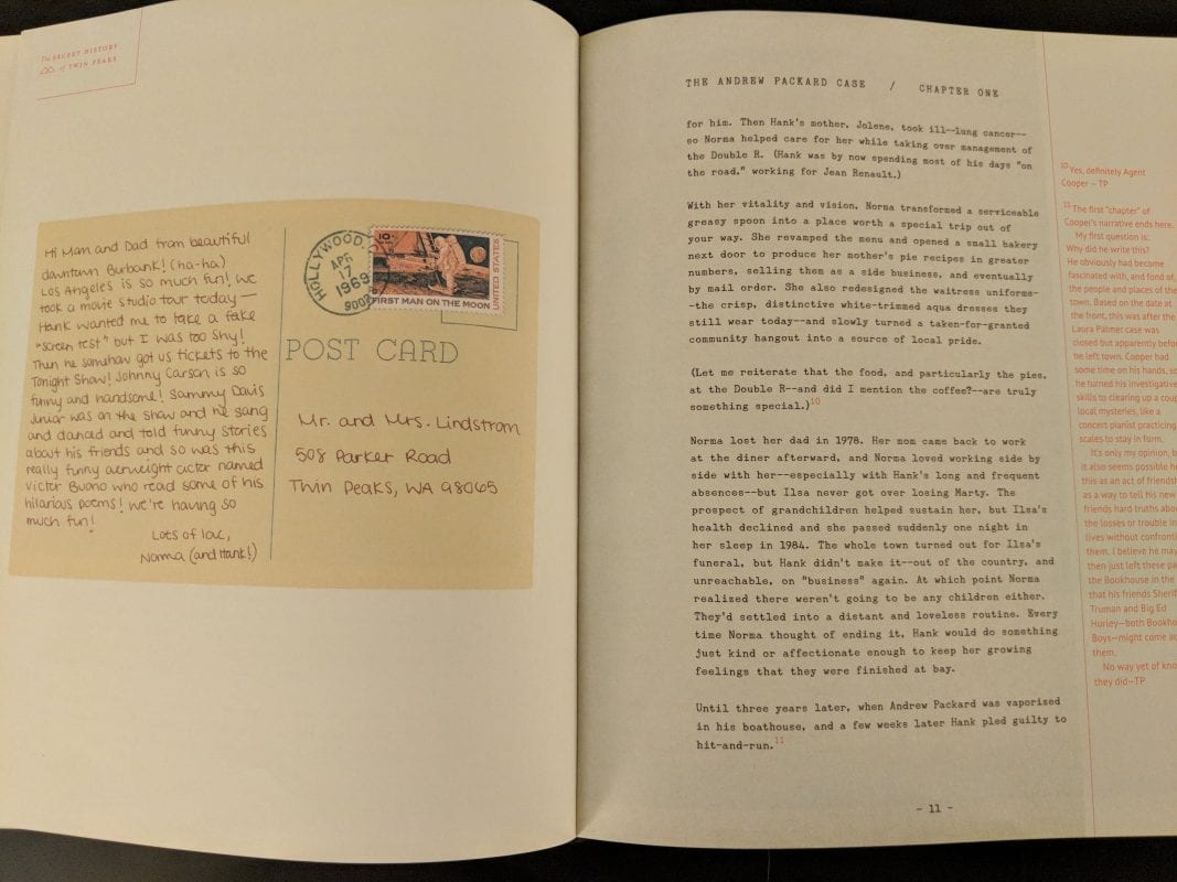 Photo of the book that features a postcard from Norma with a mysterious stamp