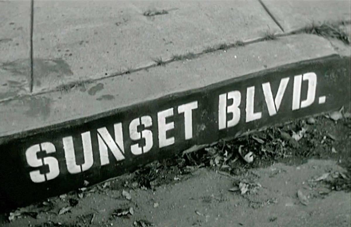 Sunset Blvd written on a curb