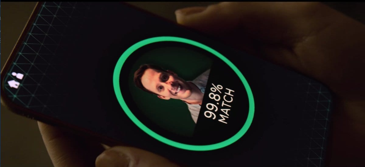 Frank's face appears within a circle on a phone that says 99.8% match