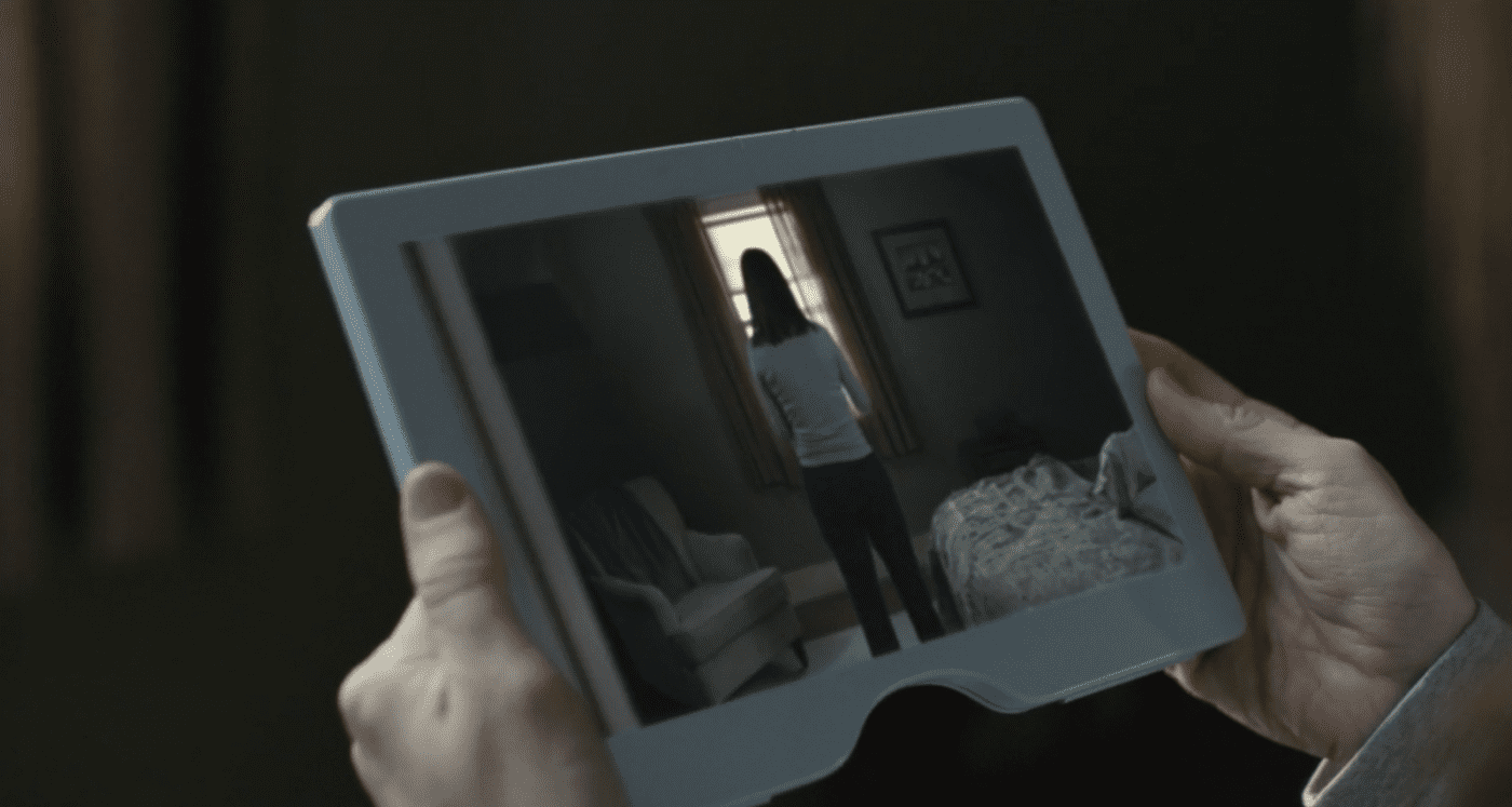 Sara looks at Marie's back on a tablet