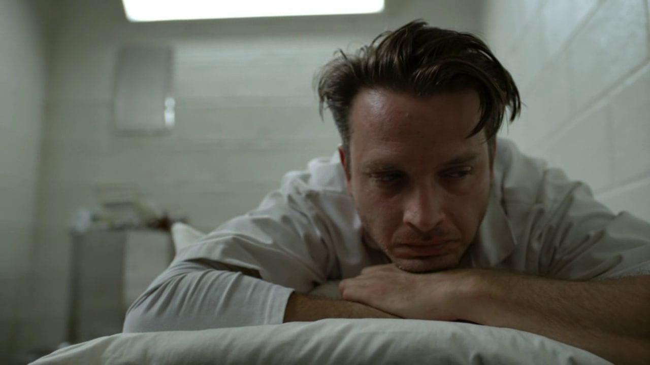 daniel in Rectify lies on a bed in a cell looking unhappy