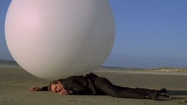 The Prisoner is run over by a giant white ball on the beach