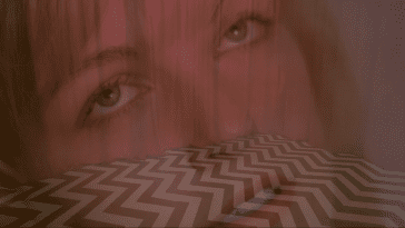 Laura Palmers face superimposed over an image of the Black Lodge