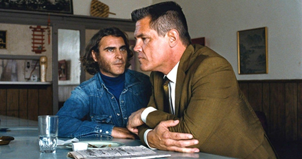 Joaquin Phoenix sat a cafe bar with a cop in Inherent Vice