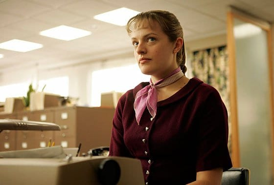 Peggy Olson sits at a typewriter in Mad Men