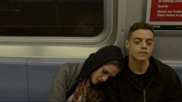 Darlene leans against Elliot's shoulder on the subway in Mr Robot