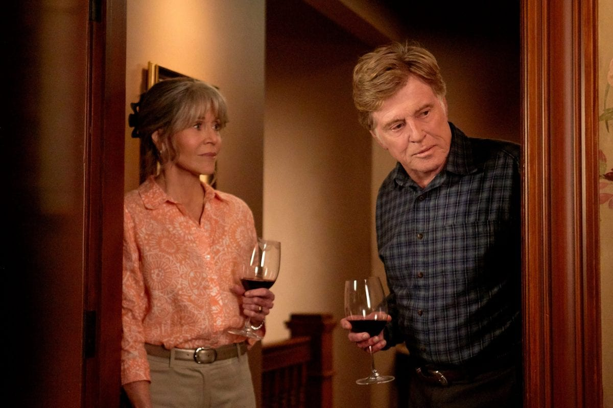 Jane Fonda and Robert Redford drink red wine together