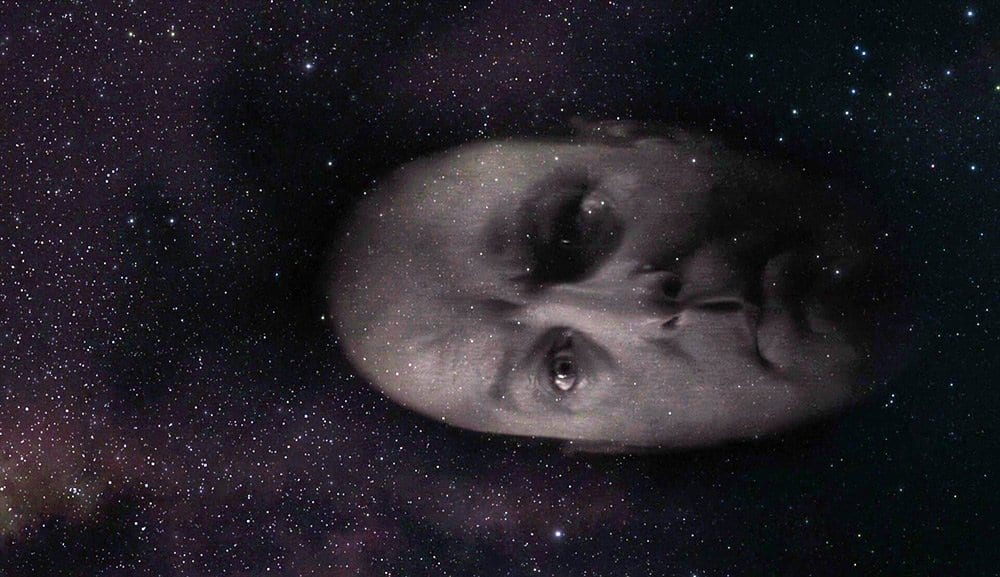 "Briggs's head floats through space as he says ""Blue Rose"""