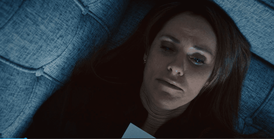 Laurie lies on the couch in her own office as a therapist, clutching the suicide note she's written