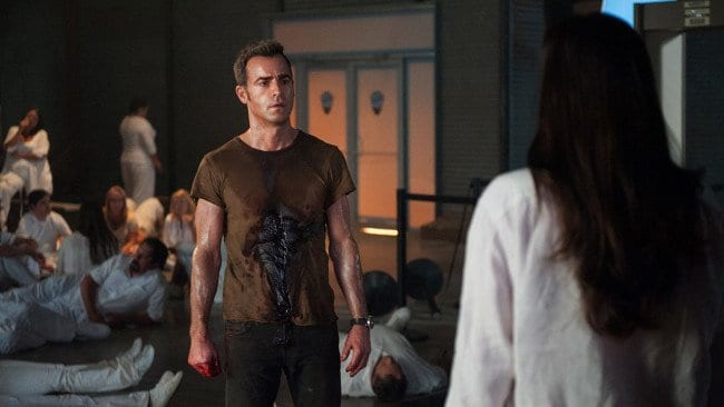 Kevin stands bleeding after being shot, surrounded by the Guilty Remnant