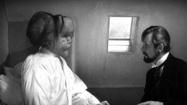 the elephant man talks to a friend
