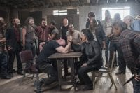 Evil Coop in an arm wrestling match