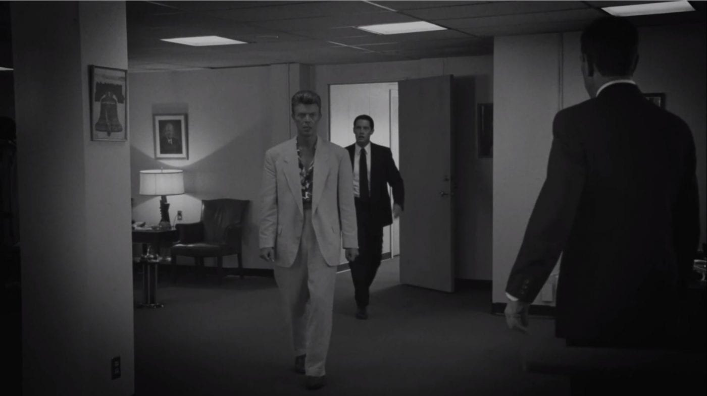 Phillip Jeffries (David Bowie) walks into the Philidelphia FBI office surprising his team