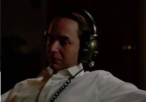 Pete Campbell wearing headphones and looking sad