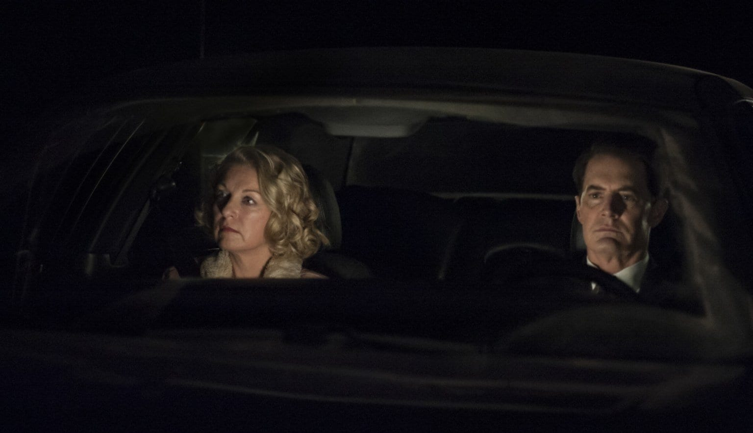 Cooper and Carrie driving at night