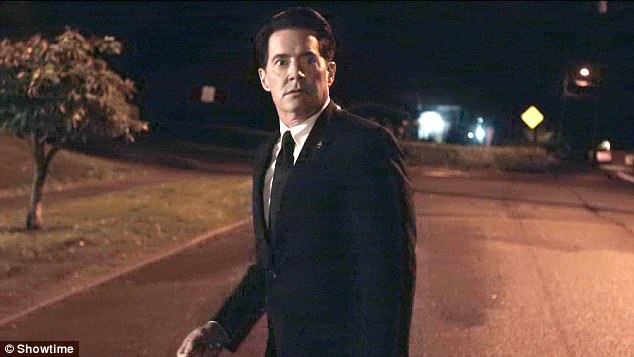 Dale Cooper in Part 18 on the street looking confused, after he went up to what he thought was the Palmer house.