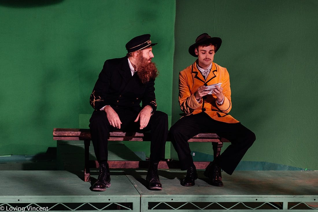 A man dressed as a ship captain and a man in a yellow blazer and hat as models for Van Gogh