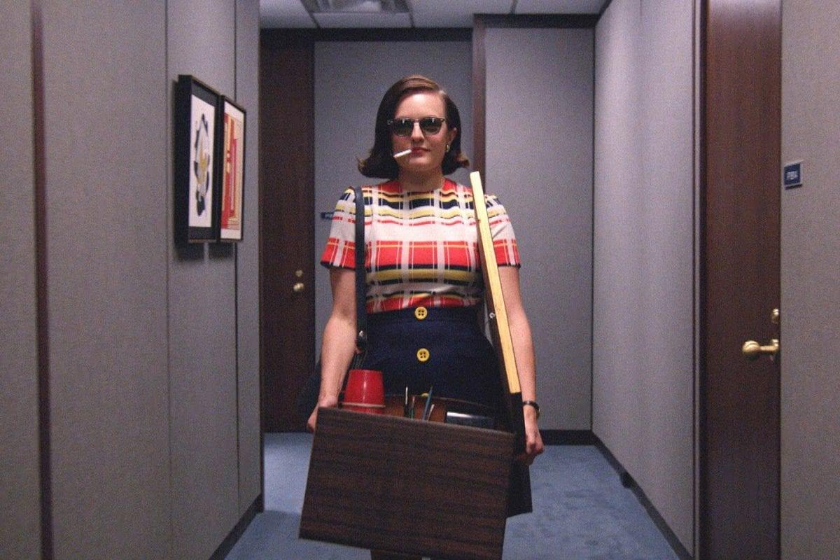 peggy looks cool wearing shades and smoking as she clears her desk