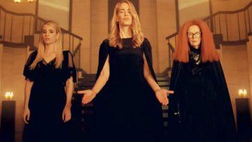 three witches wearing black summoning
