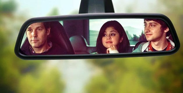 Paul Rudd, Selena Gomez and Craig Roberts reflected in a rear view mirror, in The Fundamentals of Caring