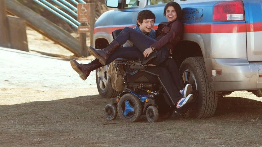 Craig Roberts and Selena Gomez laughing in The Fundamentals of Caring