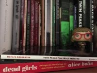 Twin Peaks books with a log lady funko pop figure