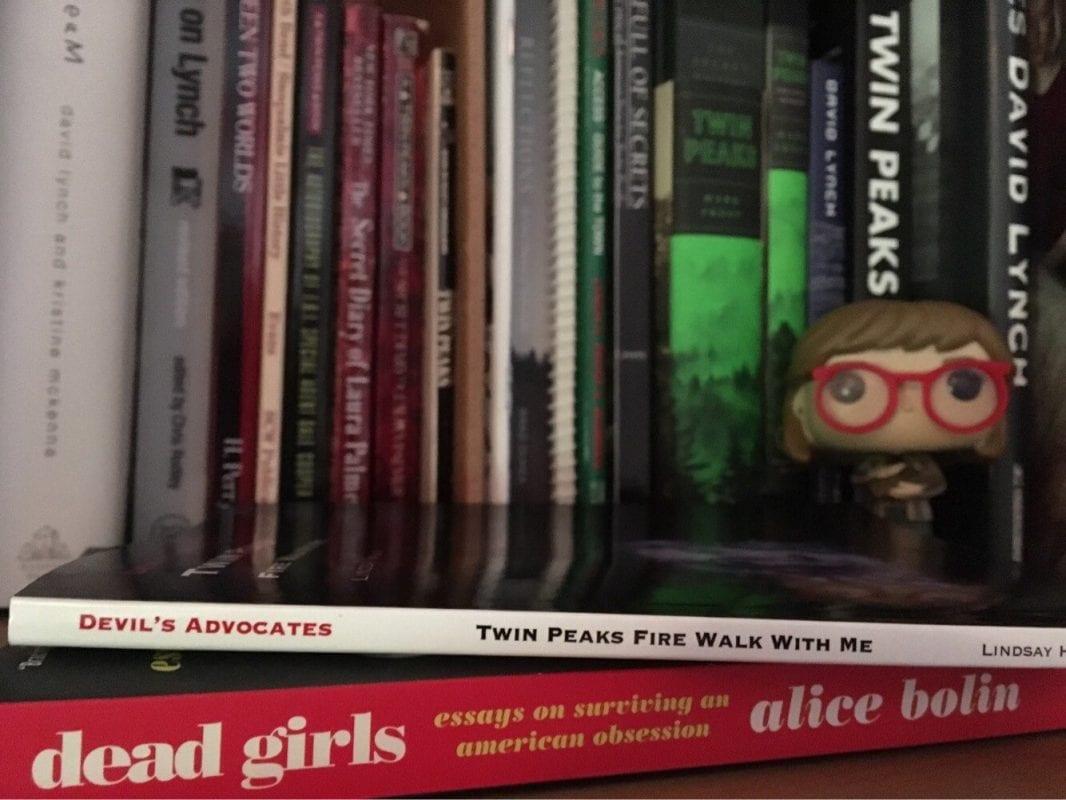 Twin Peaks books with a log lady funko pop figure