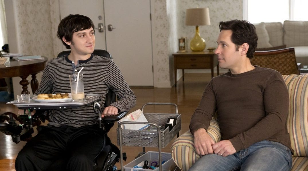 Craig Roberts eats lunch with his carer played by Paul Rudd sat beside him