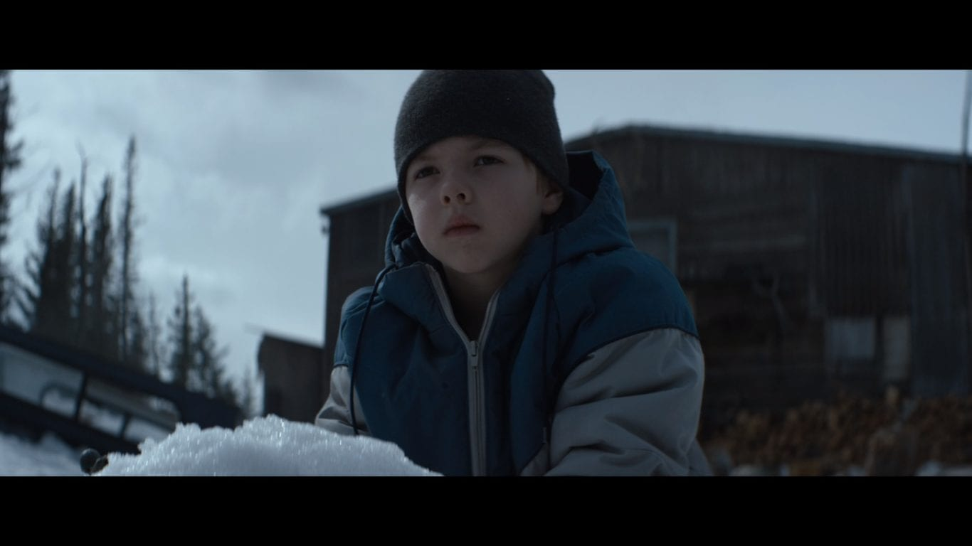 a young boy in the snow in Hold the Dark