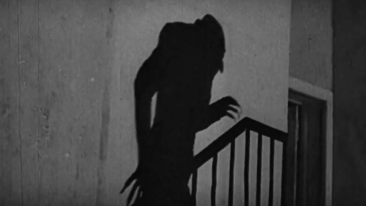 the shadow of Nosferatu climbing the stairs