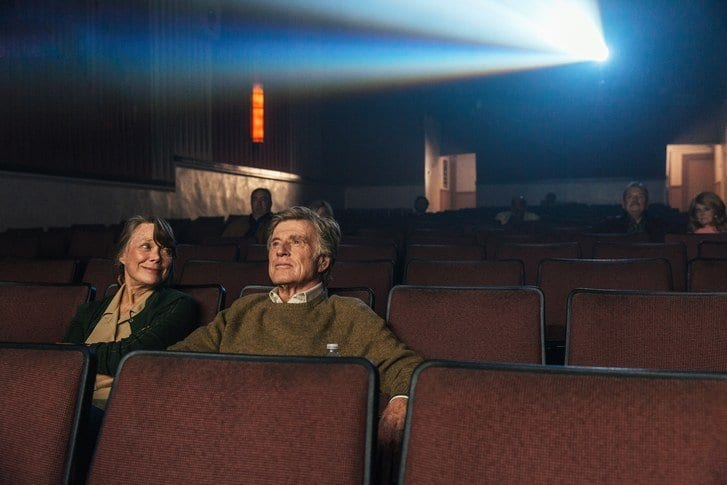 Sissy Spacek and Robert Redford sitting in a cinema in The Old Man & the Gun