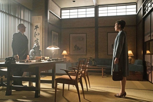 Tagomi (Cary-Hiroyuki Tagawa) and Juliana Crane (Alexa Davalos) talk in the Trade Minister's office in <em>The Man in the High Castle